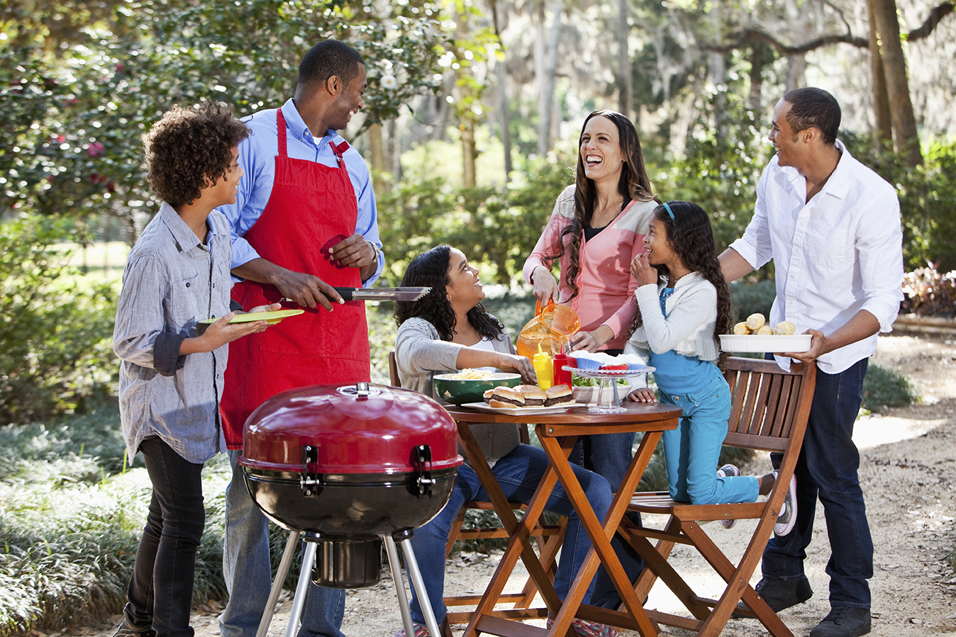Family members and friends enjoy a cookout with Ed Hipp Foods sausage products.